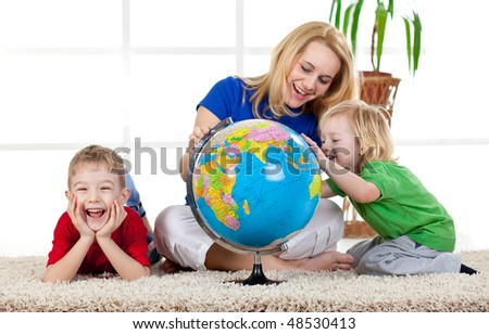 stock-photo-mother-and-her-children-sitting-on-the-carpet-playing-with-the-globe-and-smiling-48530413.jpg