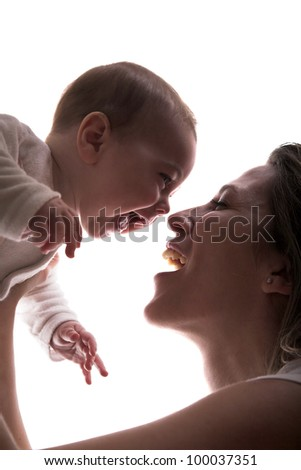 Mother and her happy little baby boy laugh together