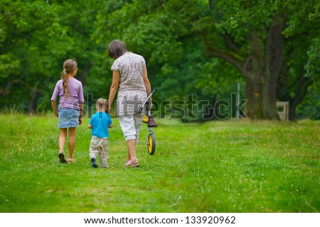 Mother and her kids walking in park