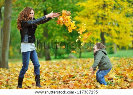 Mother and her little child having fun in a park