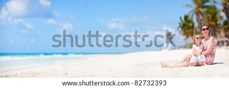 Mother and her little daughter enjoying Caribbean beach vacation