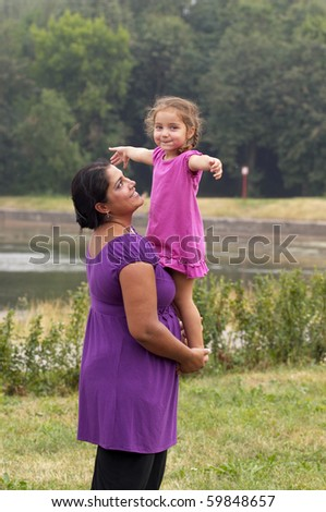 Mother and her little daughter in the city garden