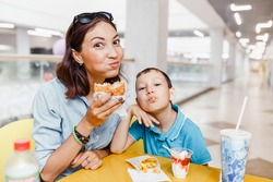 Mother And her son Having a fast food Lunch Together At The Mall