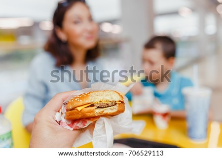 Mother And her son Having a fast food Lunch Together At The Mall #706529113