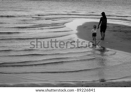 Mother and her son on Chaweng beach,Samui Thailand - stock photo