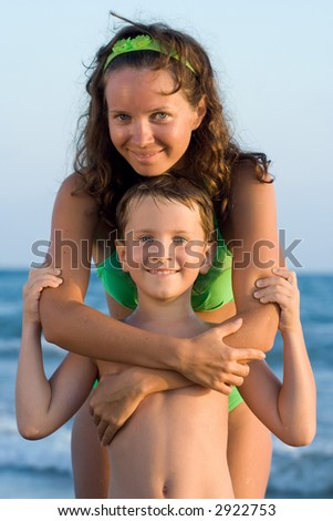 Mother and her son on the beach