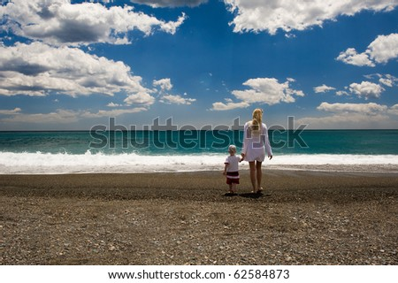 Mother and her toddler son on the beach