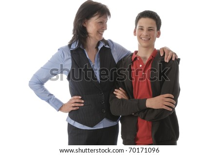 Mother and her young son stand next to each other, is proud and hugged the boy in front of white background.