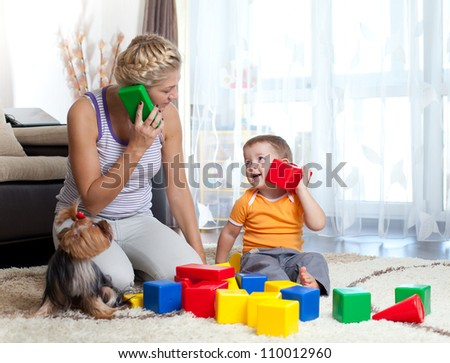 mother and kid boy role-playing together indoor