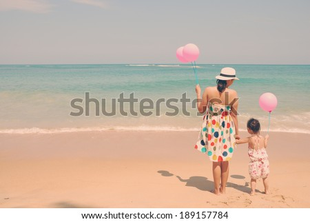 mother and  kid on the beach...