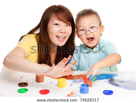 Mother and kid spending some time together painting with their hands