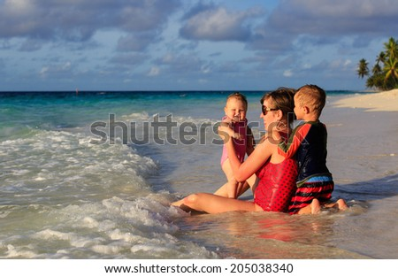 mother and kids enjoying tropical sea vacation