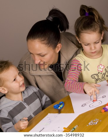 Mother and kids spending time together doing arts and craft