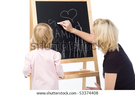 Mother and little daughter writing on a blackboard. Isolated on white
