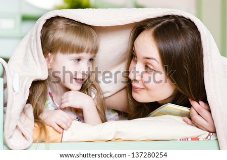 Mother and little girl  having  time together