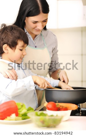 Mother and little son in the kitchen