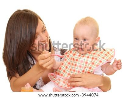 mother and 8 months baby girl with baby food isolated on white