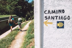 Mother and son as pilgrims walk on St.Santiago Way, North Spain. .