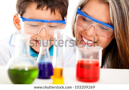 Mother and son at the lab playing scientist - isolated over white