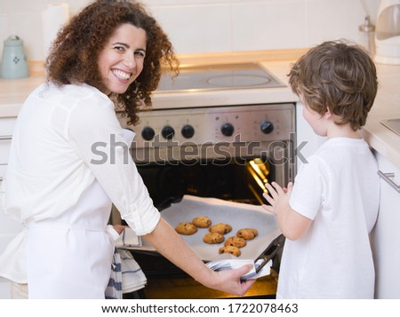 Mother and son baking at home