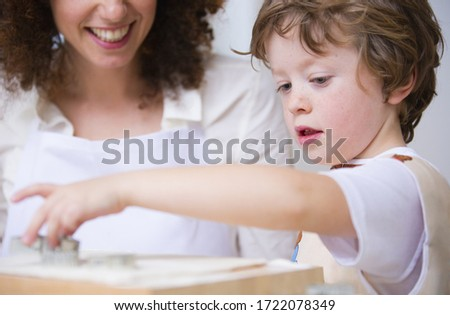 Mother and son baking at home, close up