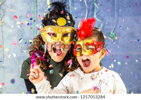 Mother and son celebrating Carnival at home #1257053284