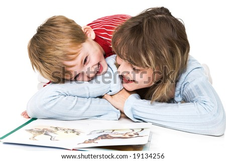 Mother and son cheerfully read the book