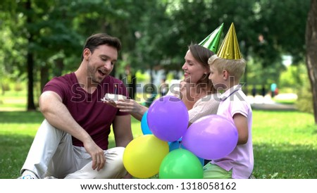 Mother and son congratulate dad on birthday, pleasant surprise from close people #1318058162