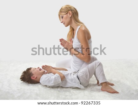 mother and son do yoga before bed stock photo 92267335