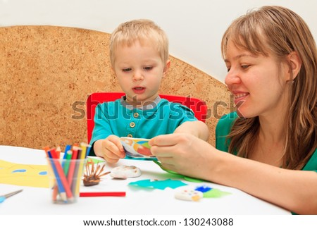 mother and son drawing together, good for kindergarten, daycare concepts