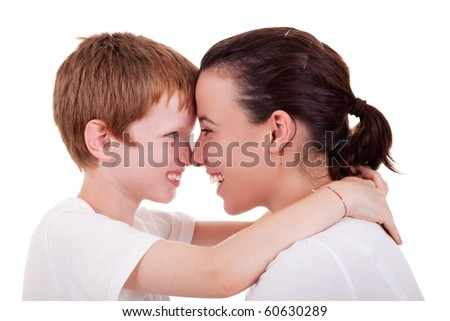 mother and son embracing cheek to cheek , isolated on white background, studio shot - stock photo