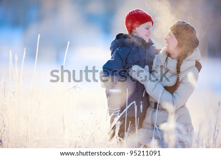 Mother and son enjoying beautiful cold winter day