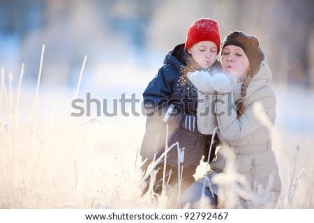 Mother and son enjoying beautiful winter day outdoors