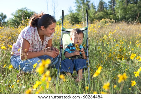 Mother and son enjoying late summer afternoon in nature. Shallow DOF, focus point is on boy's face.