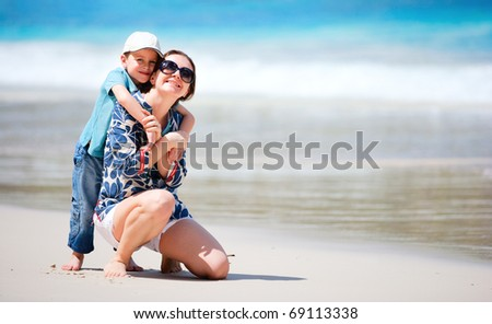 Mother and son having fun beach vacation