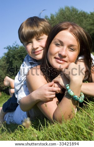 Mother and son having fun in a meadow