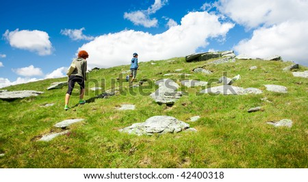 Mother and son hiking in a mountain landscape