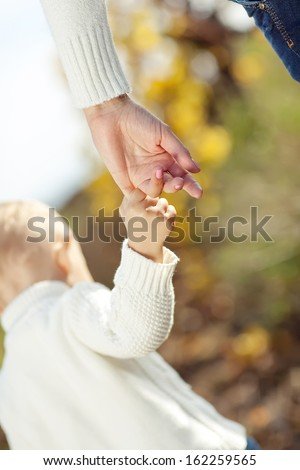 Mother and son holding hand in hand