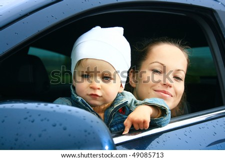 mother and son in a new car