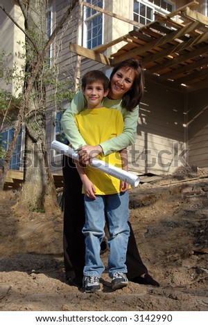 Mother and son in front of house under construction