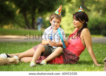 mother and son in park on birthday
