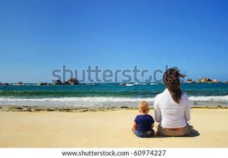 Mother and son looking at the waves on the beach of the Atlantic, France - stock photo