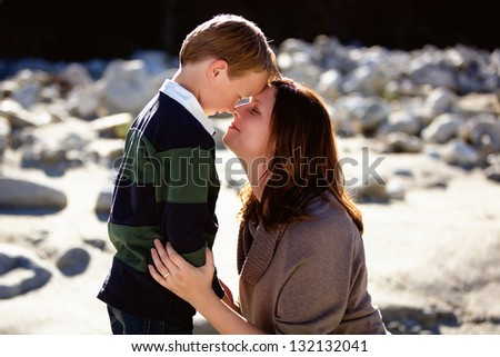 Mother and son loving one another in tender moment