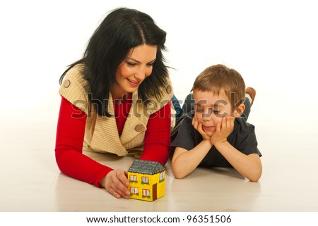Mother and son lying down on floor in their home and having conversation about a new house