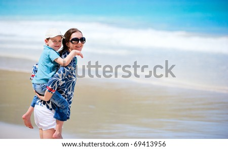 Mother and son on beach vacation having fun
