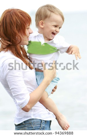 mother and son on natural background
