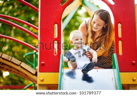 Mother and son on playground