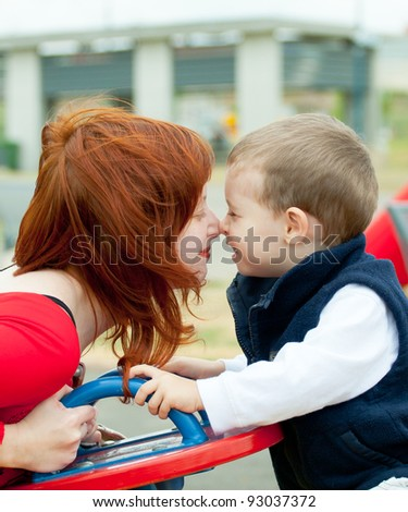 Mother and son on playground. Children send a thoughts.