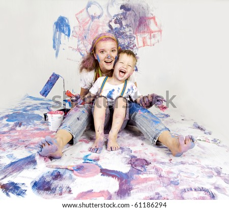 Mother and son paint the walls