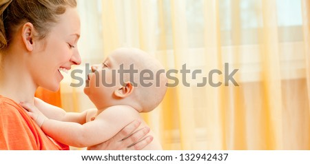 Mother and son play in the bedroom